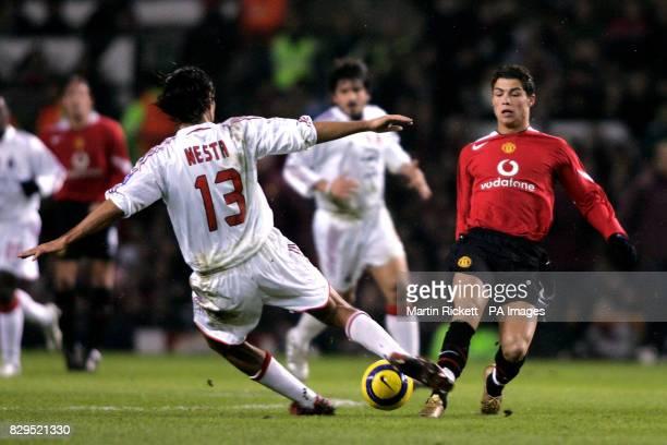 Manchester United's Cristiano Ronaldo challenges AC Milan's Alessandro Nesta