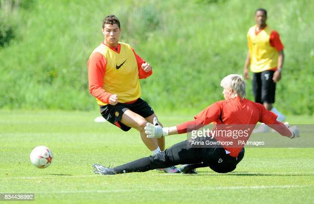 Manchester United's Cristiano Ronaldo comes up against goalkeeper Thomas Kuszczak during the Champions League Media Day at Carrington Training Ground...