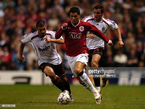 Manchester United's Cristiano Ronaldo gets away from AC Milan's Gennaro Gattuso and Massimo Oddo