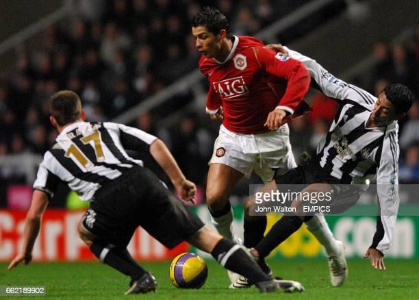Manchester United's Cristiano Ronaldo goes past Newcastle United's Nolberto Solano and Scott Parker