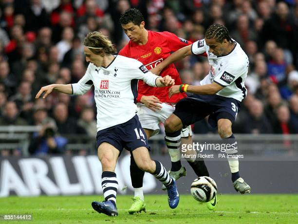 Manchester United's Cristiano Ronaldo is challenged by Tottenham Hotspur's Luka Modric and Benoit AssouEkotto as they battle for the ball