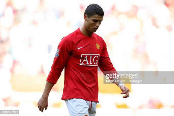 Manchester United's Cristiano Ronaldo looks dejected as he makes his way from the field at half time