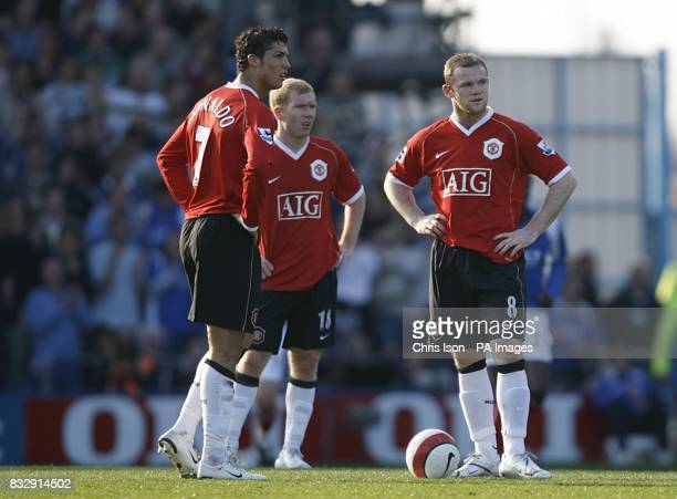 Manchester United's Cristiano Ronaldo Paul Scholes and Wayne Rooney stand dejected after Portsmouth's Matthew Taylor scored the opening goal