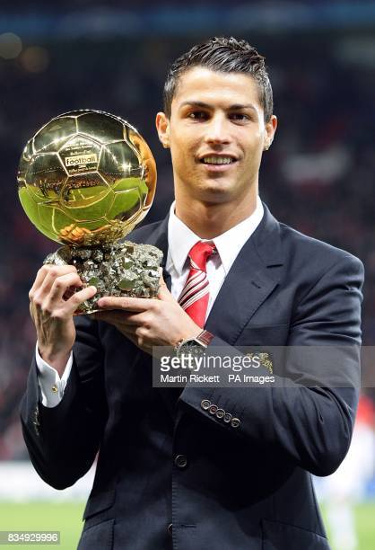 Manchester United's Cristiano Ronaldo poses with the Ballon d'Or before kick off