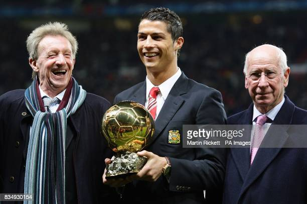 Manchester United's Cristiano Ronaldo poses with the Ballon d'Or before kick off alongside Denis Law and Sir Bobby Charlton