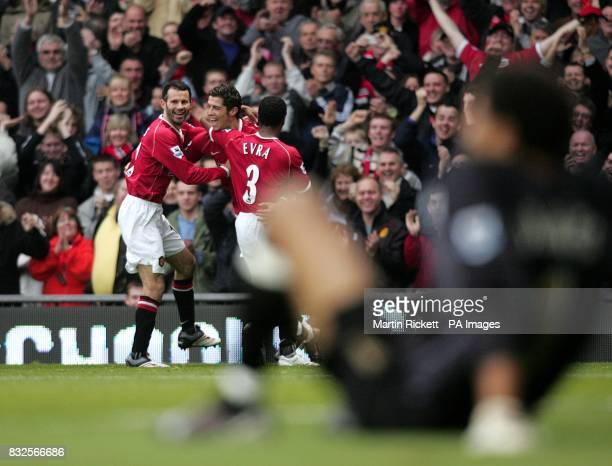 Manchester United's Cristiano Ronaldo scores his sides second goal from a free kick as Portsmouth goalkeeper David James sits dejected