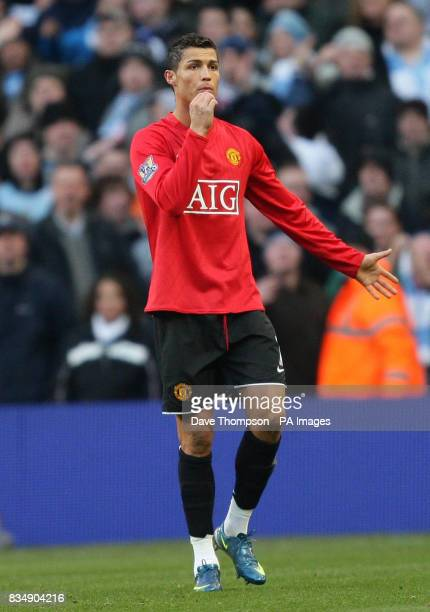 Manchester United's Cristiano Ronaldo shrugs his shoulders after he is sent off for handling the ball by referee Howard Webb during the Barclays...