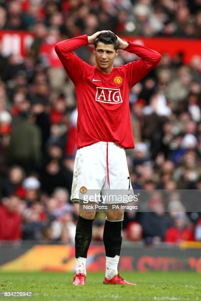 Manchester United's Cristiano Ronaldo stands dejected after missing a goalscoring opportunity