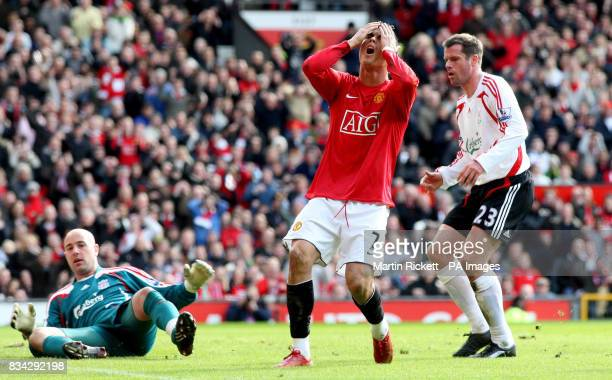 Manchester United's Cristiano Ronaldo stands dejected after missing a chance during the Barclays Premier League match at Old Trafford Manchester