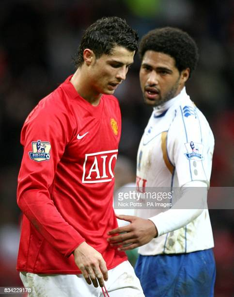 Manchester United's Cristiano Ronaldo stands dejected as Portsmouth's Glen Johnson consoles him after the final whistle