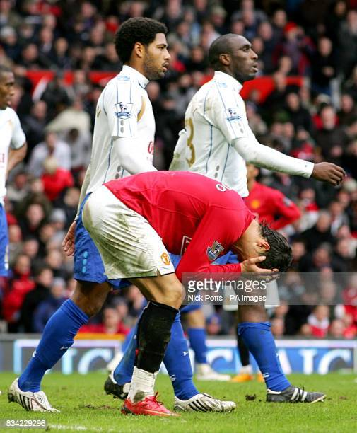 Manchester United's Cristiano Ronaldo stands dejected as Portsmouth's Glen Johnson and Sol Campbell look on