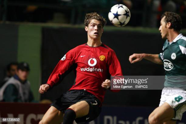 Manchester United's Cristiano Ronaldo takes on Panathinaikos' Giannis Goumas
