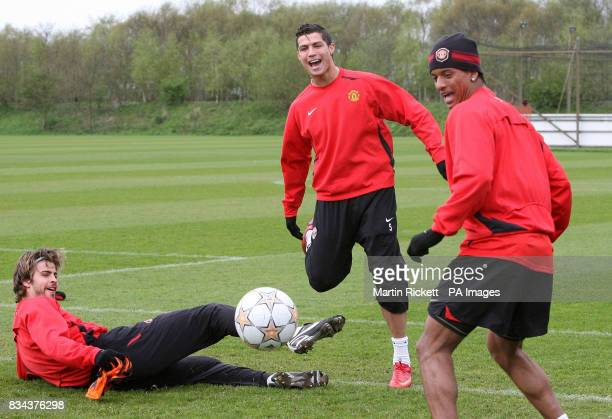 Manchester United's Cristiano Ronaldo with Gerard Pique and Luis Nani during the training session at Carrington Training Ground Manchester