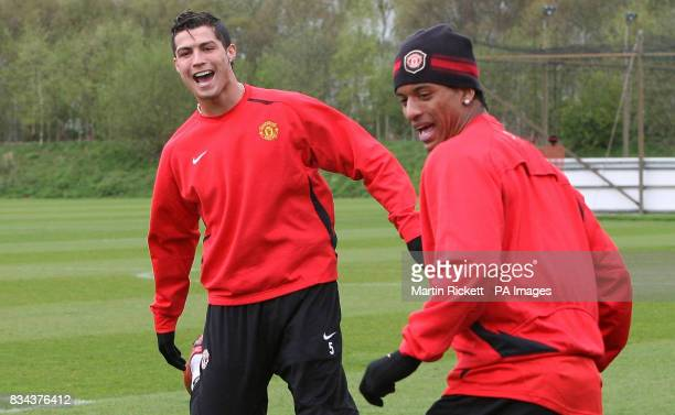 CROP* Manchester United's Cristiano Ronaldo with Luis Nani during the training session at Carrington Training Ground Manchester