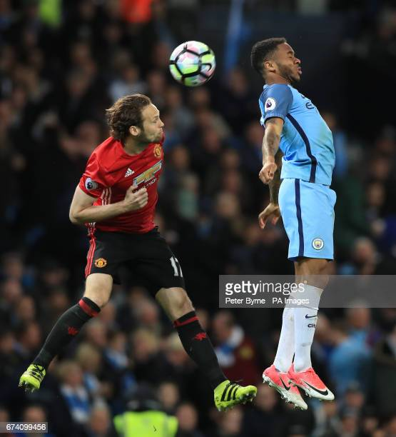 Manchester United's Daley Blind and Manchester City's Raheem Sterling battle for the ball during the Premier League match at the Etihad Stadium...