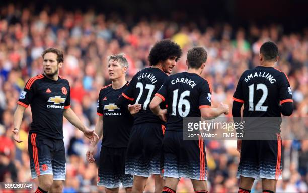 Manchester United's Daley Blind Bastian Schweinsteiger Marouane Fellaini Michael Carrick and Chris Smalling form a defensive wall