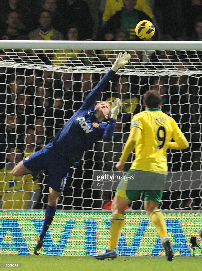"""Manchester United's Danish goalkeeper Anders Lindegaard (L) cannot prevent Anthony Pilkington (not pictured) scoring the opening goal during the English Premier League football match between Norwich City and Manchester United at Carrow Road stadium in Norwich, England on November 17, 2012. Norwich City won the game 1-0. USE. No use with unauthorized audio, video, data, fixture lists, club/league logos or """"live"""" services. Online in-match use limited to 45 images, no video emulation. No use in betting, games or single club/league/player publications."""