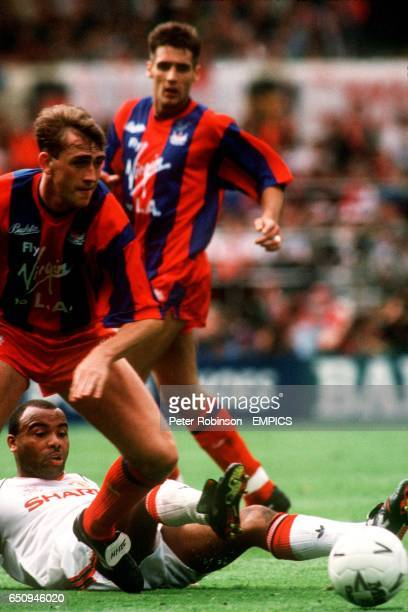 Manchester United's Danny Wallace slides in on Crystal Palace's Andy Thorn