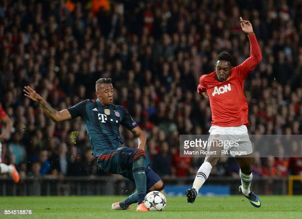 Manchester United's Danny Welbeck and Bayern Munich's Jerome Boateng battle for the ball