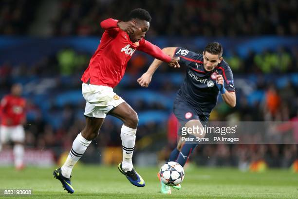 Manchester United's Danny Welbeck and Olympiakos' Kostas Manolas battle for the ball
