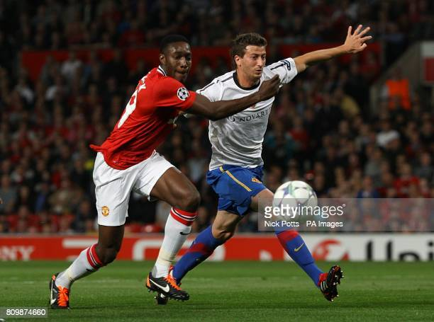 Manchester United's Danny Welbeck battles with Basle's David Angel Abraham in the penalty area