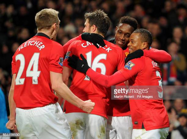 Manchester United's Danny Welbeck celebrates after scoring their second goal with teammates during the Barclays Premier League match at Old Trafford...