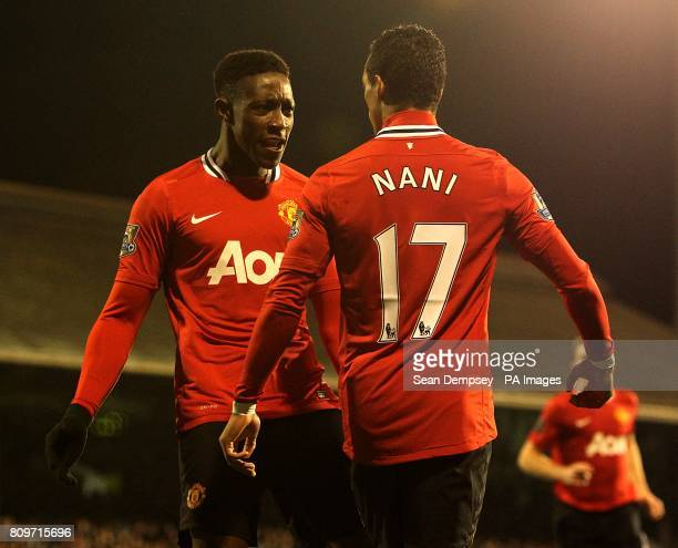 Manchester United's Danny Welbeck celebrates scoring his side's first goal of the game with teammate Luis Nani