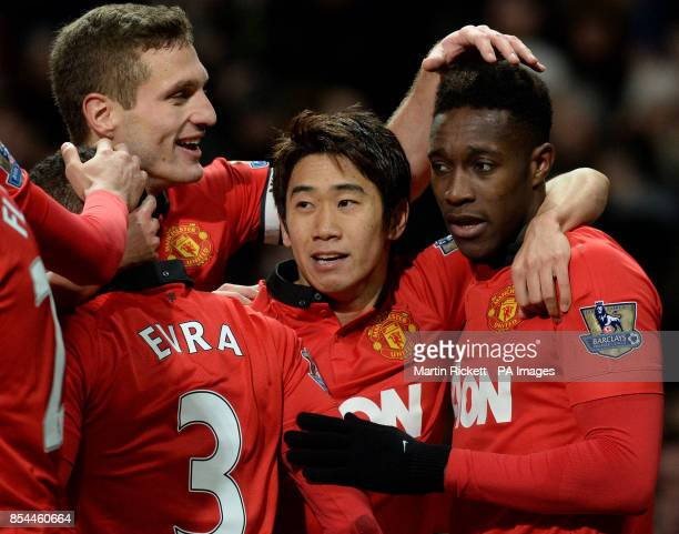 Manchester United's Danny Welbeck celebrates with Shinji Kagawa and Nemanja Vidic after scoring during the Barclays Premier League match at Old...