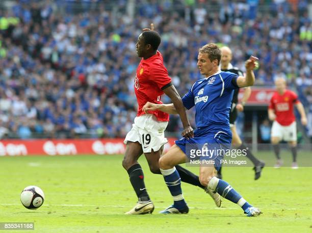 Manchester United's Danny Welbeck goes down under a tackle by Everton's Phil Jagielka but no penalty is given