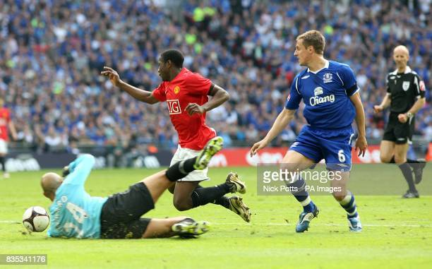Manchester United's Danny Welbeck goes down under a tackle by Everton's Phil Jagielka but no penalty is given by referee Mike Riley