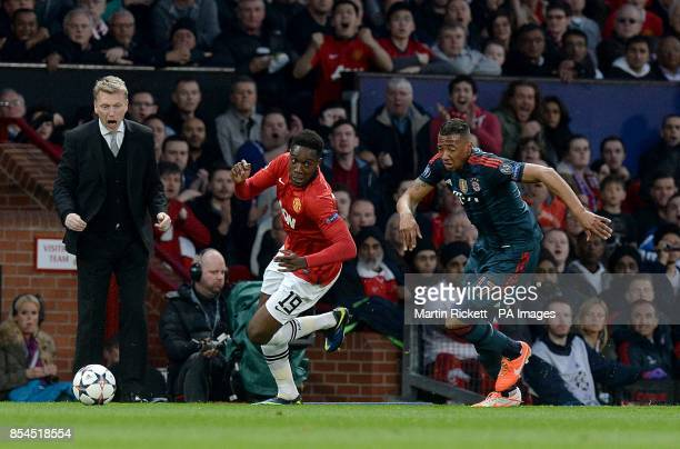Manchester United's Danny Welbeck is chased by Bayern Munich's Jerome Boateng whilst Manchester United manager David Moyes shouts instructions on the...