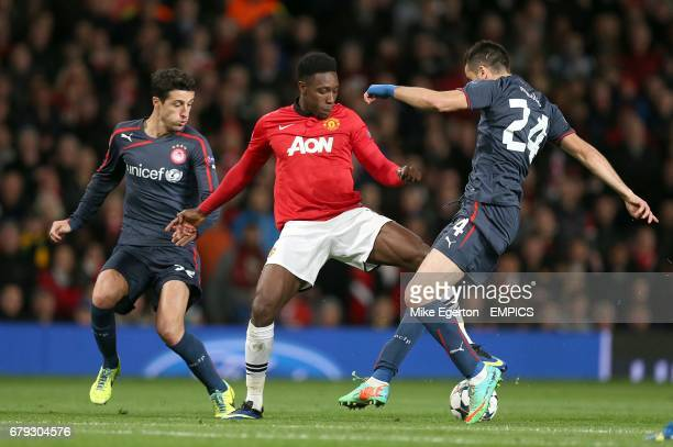 Manchester United's Danny Welbeck skips past a tackle of Olympiakos' Kostas Manolas before being fouled in the build up to the freekick which was...