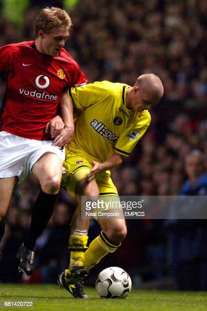 Manchester United's Darren Fletcher and Charlton Athletic's Paul Konchesky battle for the ball