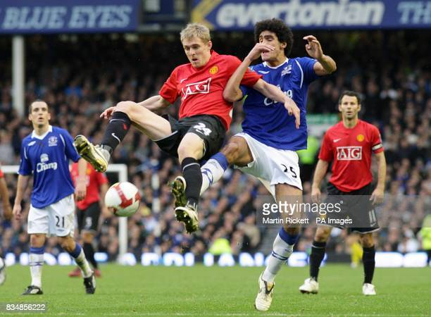 Manchester United's Darren Fletcher and Everton's Marouane Fellaini in action