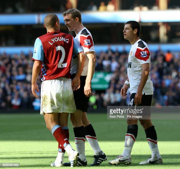 Manchester United's Darren Fletcher gets involved after teammate Javier Hernandez and Aston Villa's Luke Young get involved in an altercation