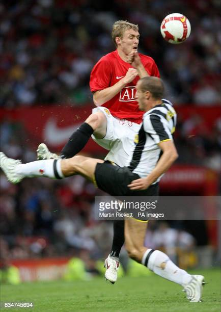 Manchester United's Darren Fletcher in action with Juventus' Giorgio Chiellini during the preseason friendly match at Old Trafford Manchester