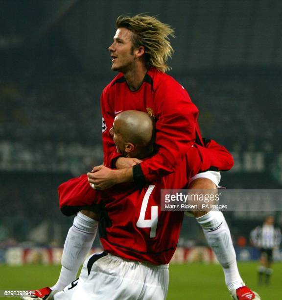 Manchester United's David Beckham and Juan Veron celebrate after Ryan Giggs scored against Juventus during their Champions League group D phase 2...