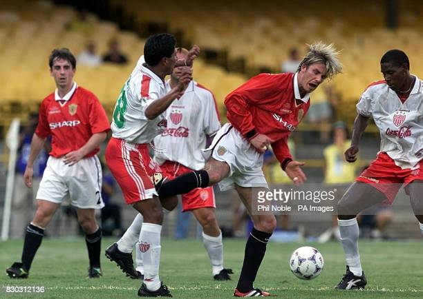 Manchester United's David Beckham and Necaxa's Jose Milian in a challenge which saw him sent off during their World Club Championship match at the...