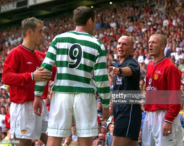 LEAGUE Manchester United's David Beckham clashes with Celtic's Chris Sutton during the Ryan Giggs Testimonial game at Old Trafford Manchester