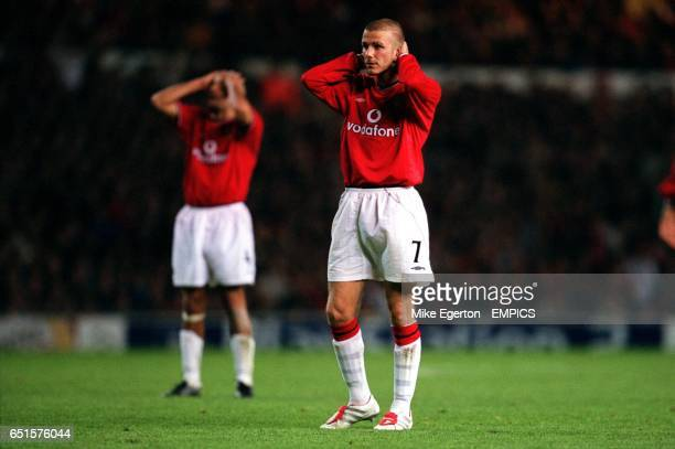 Manchester United's David Beckham holds his head after missing the target with a free kick