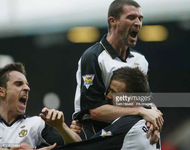 Manchester United's David Beckham is joined by Roy Keane and Gary Neville after scoring the equalizer against West Ham during their FA Barclaycard...