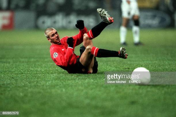 Manchester United's David Beckham keeps his eyes on the ball as he falls backwards