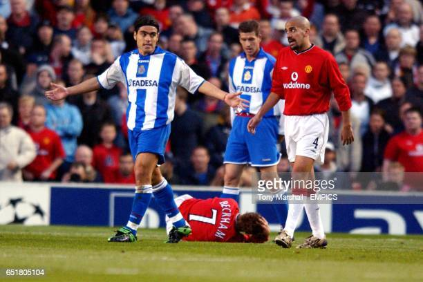 Manchester United's David Beckham lies on the ground as Deportivo La Coruna's Aldo Duscher shrugs his shoulders
