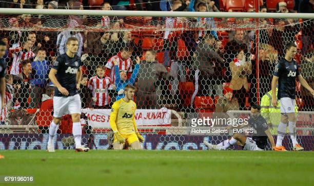Manchester United's David De Gea centre looks on after Phil Bardsley scores Sunderland's opening goal during the Capital One Cup Semi Final First Leg...