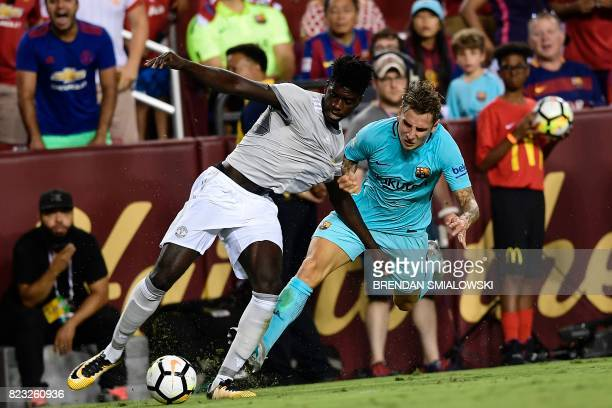 Manchester United's defender Axel Tuanzebe and Barcelona's defender Lucas Digne vie for the ball during their International Champions Cup football...
