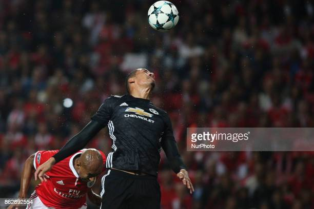 Manchester United's defender Chris Smalling vies with Benfica's defender Luisao during the Champions League football match between SL Benfica and...
