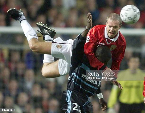 Manchester United's defender Henning Berg leaps high to beat Marseille's striker Ibrahima Bakayoko at Old Trafford in their Champions League match
