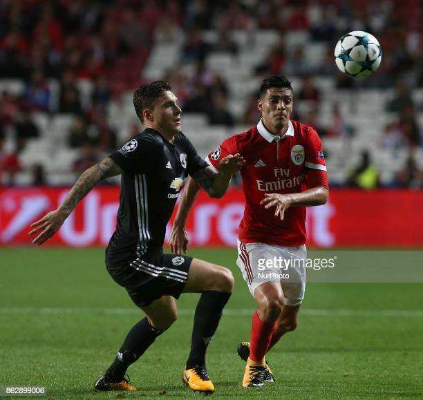 Manchester Uniteds defender Victor Lindelof from Sweden and Benficas forward Raul Jimenez from Mexico during the match between SL Benfica v...