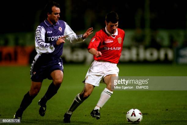 Manchester United's Denis Irwin turns away from Fiorentina's Abel Balbo