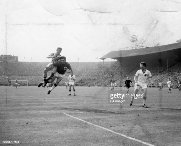 Manchester United's deputy goalkeeper Jackie Blanchflower is jolted by Villa's Leslie Smith during the Cup Final at Wembley Villa won the match 21